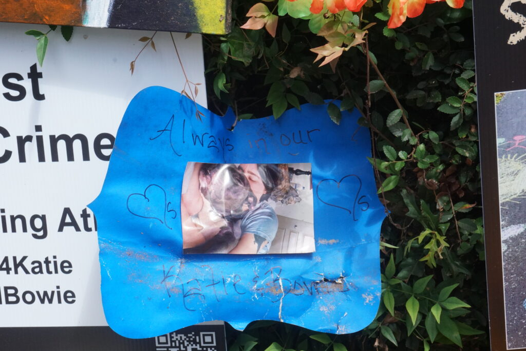 A sign from the memorial for Katie Janness at the Ivan Allen Jr. gate to Piedmont Park